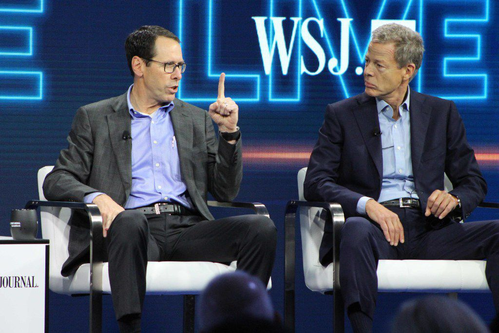 AT&T chief executive Randall Stephenson (left) and Time Warner chief executive Jeffrey Bewkes defend the proposed mega-merger of the companies at a WSJD Live technology conference in Laguna Beach, Calif. (Glenn Chapman/Agence France-Presse)