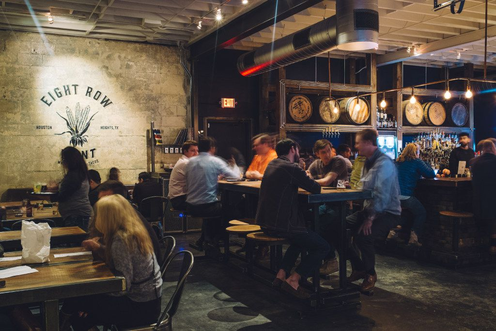 Eight Row Flint, an ice house with specialty drinks and a menu of tacos featuring handmade tortillas, is a popular gathering place in the Houston Heights district.