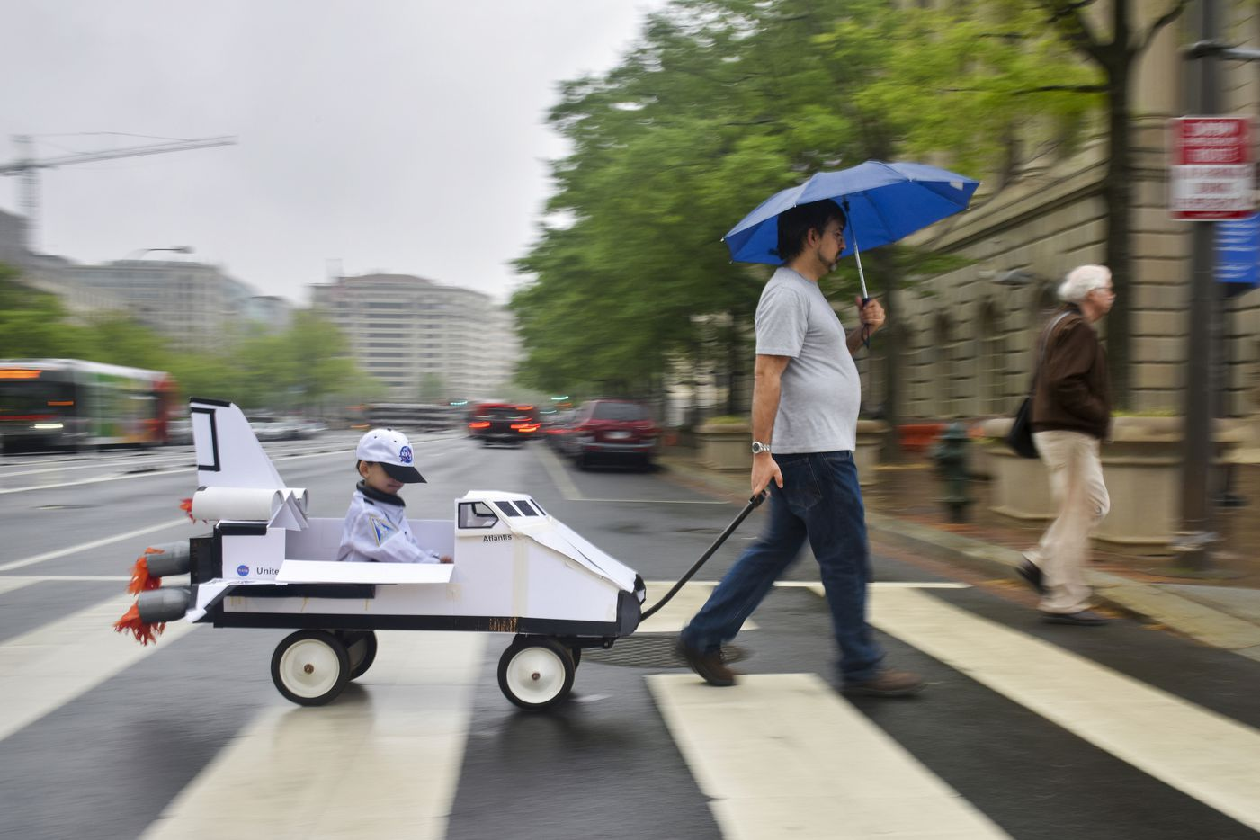 Tomas Carbonell pulls his son, Felipe Carbonell-Boon, in a mock NASA space shuttle as advocates gather on the National Mall for the March for Science on Saturday, April 22, 2017, in Washington. The father works for an environmental defense fund geared toward climate change and clean air. (Jahi Chikwendiu/The Washington Post)