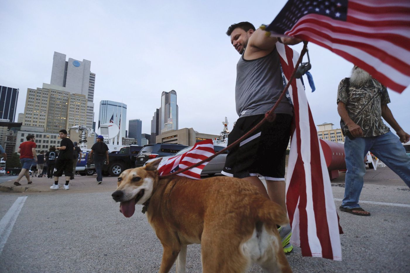 Clad in U.S. flags, Jason Hone of Oak Cliff  arrives to the March Against White Supremacy rally with his dog Gonzo.