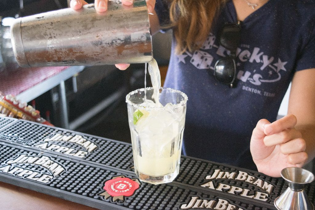 Bartender Kelley Brackney pours out a margarita at Lucky Lou's on National Tequila Day.