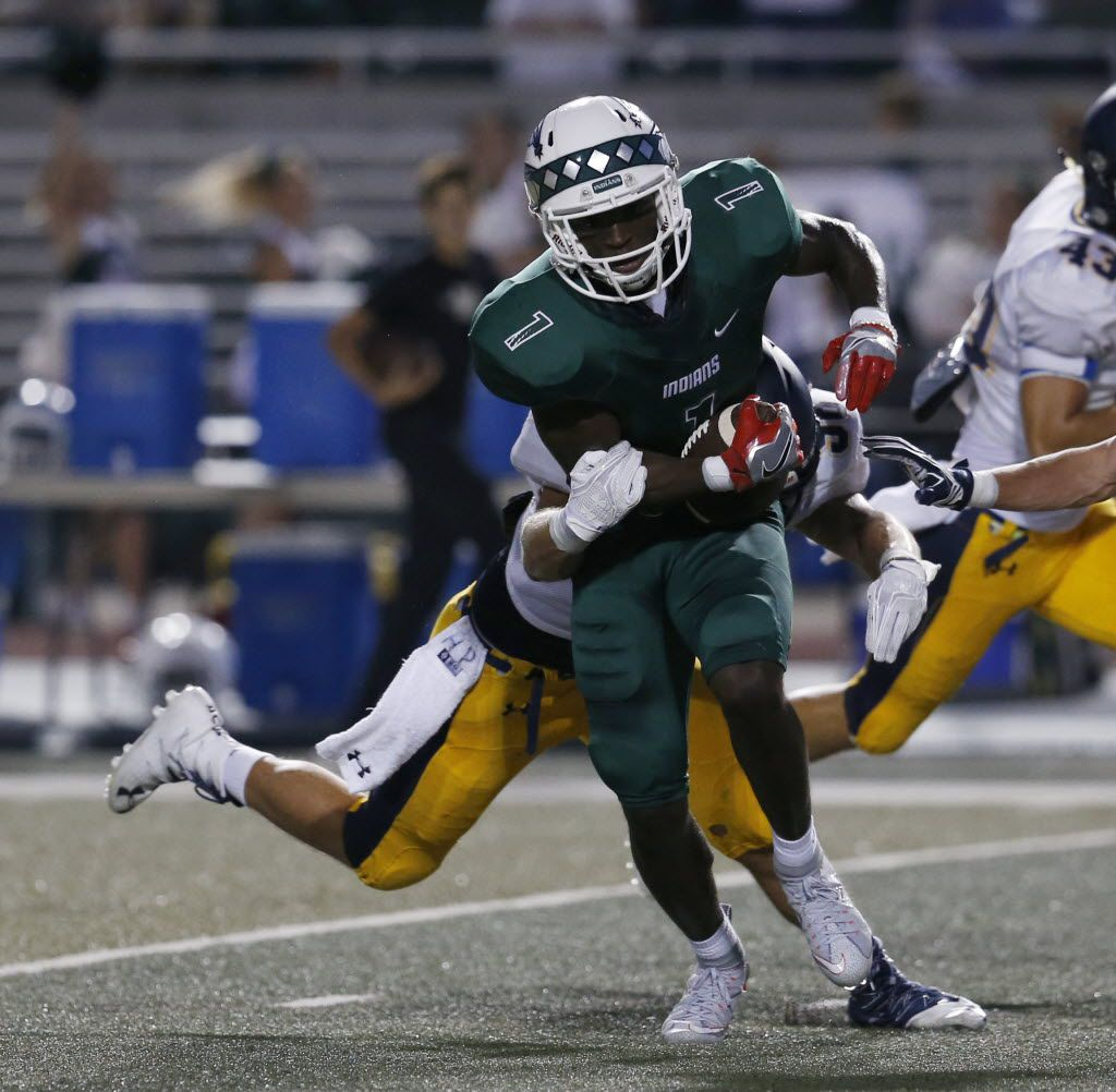 FILE - Waxahachie receiver Jalen Reagor (1) is tackled by Highland Park defensive player Bennett Brock (96) during the first quarter at Lumpkins Stadium in Waxahachie, Texas on Sept. 2, 2016. (Rose Baca/The Dallas Morning News)