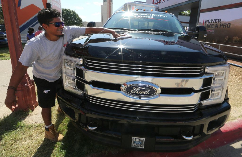 David Ruiz polishes a fully loaded F-450 Super Duty Limited, the biggest version of the Ford F-Series, on display at the State Fair of Texas.