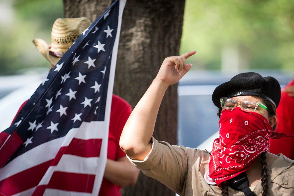 """Opponents of the SB4 law, Texas' """"sanctuary city"""" legislation, rally outside the  offices of State Rep. Matt Rinaldi on Wednesday, May 31, 2017, in Farmers Branch, Texas."""