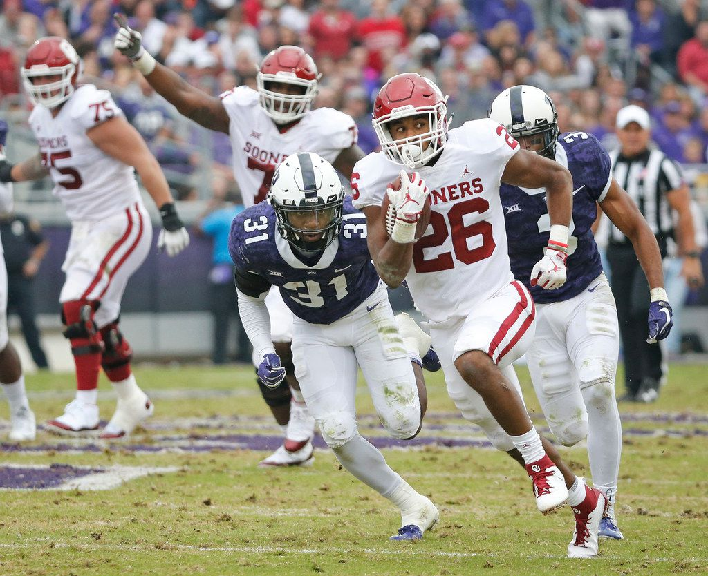 Oklahoma Sooners running back Kennedy Brooks (26) motors downfield on a long second-quarter run during the Oklahoma Sooners vs. the TCU Horned Frogs NCAA football game at Amon G. Carter Stadium in Fort Worth, Texas on Saturday, October 20, 2018. (Louis DeLuca/The Dallas Morning News)