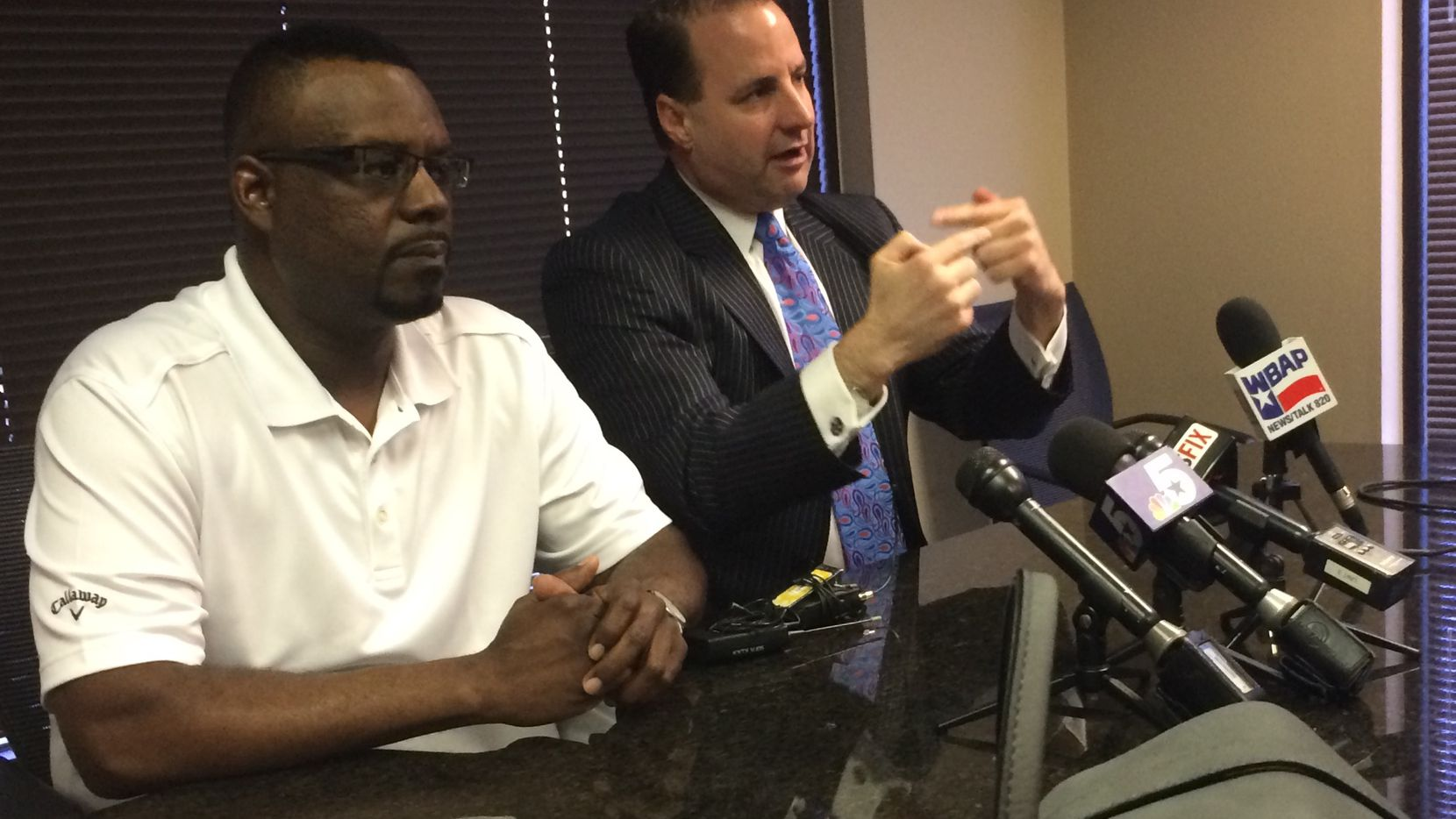 Sean Harrison, left, the older brother of mental patient Jason Harrison, who was shot and killed June 14, 2014, by Dallas police officers. Harrison speaks Monday, March 16, 2015, at a news conference with the family's attorney, Geoff Henley (right).