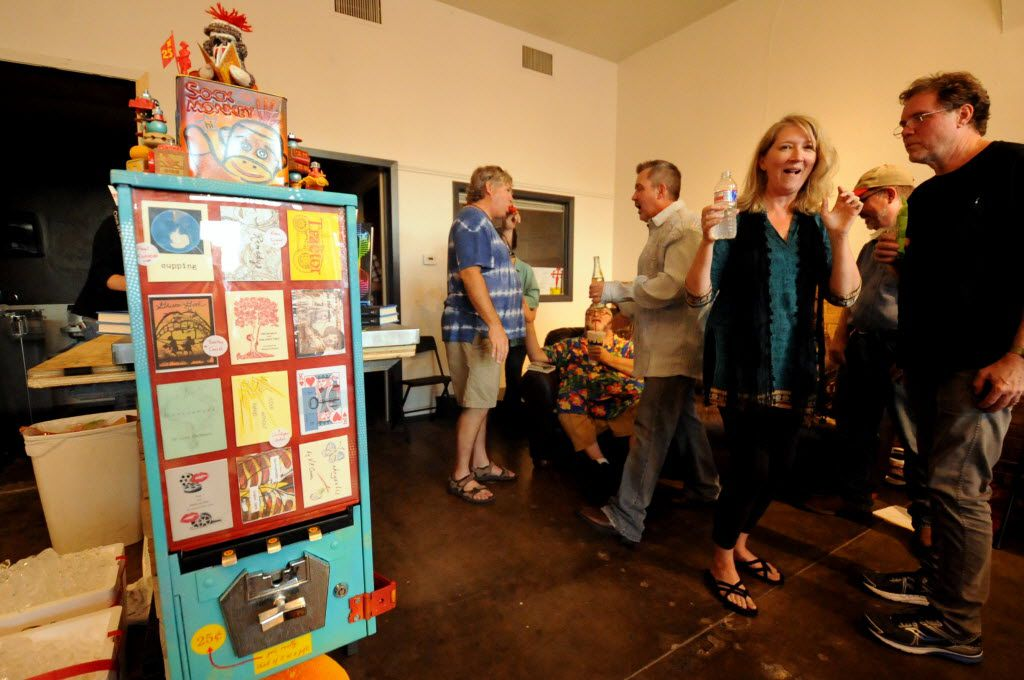 Guests and writers gather for libations and poetry readings at White Rock Zine Machine launch party at Deep Vellum Publishing in Dallas, TX on July 22, 2016. (Alexandra Olivia/ Special Contributor)