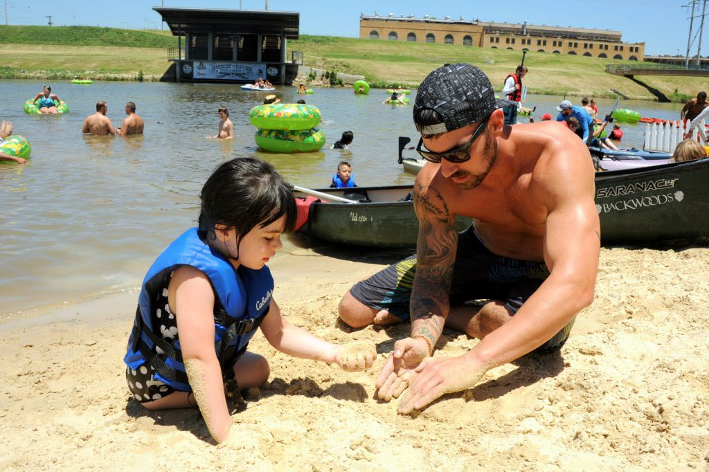 Cade and Harley Carpenter build a sand castle at Sunday Funday at Panther Island Pavilion in Fort Worth on July 19, 2015.