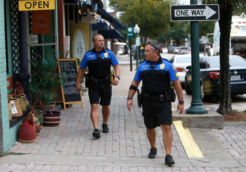 McKinney neighborhood police officers Randy Patton (left) and Sgt. Damian Guerrero patrol downtown McKinney. (Rose Baca/Staff Photographer)