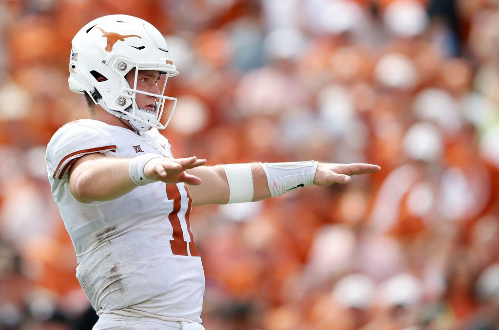 Texas Longhorns quarterback Sam Ehlinger (11) before the snap during the second half of play at the Cotton Bowl in Dallas on Saturday, October 6, 2018. Texas Longhorns defeated Oklahoma Sooners 48-45.