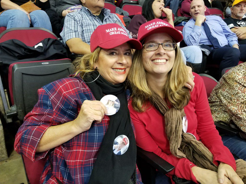 Debbie Driscoll, left, and her friend Leslie Biggs, both from Houston, attend the Donald Trump-Ted Cruz rally in Houston at the Toyota Center on Oct. 22, 2018.