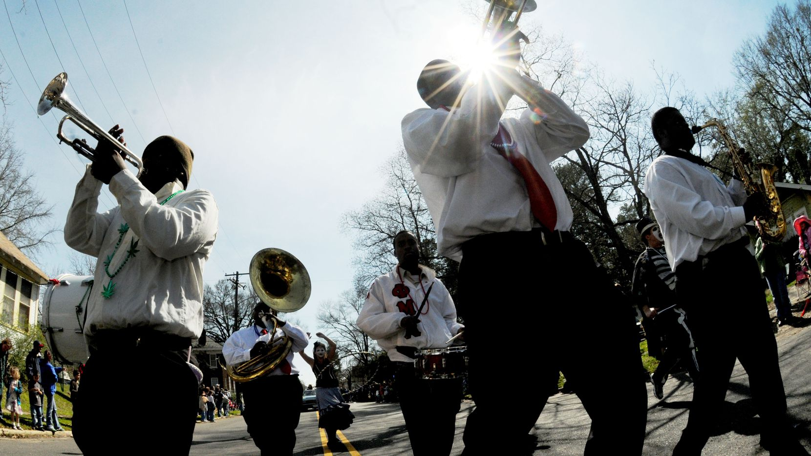 The Red and Black Brass band during the Krewe of Highland Mardi Gras parade on Creswell Avenue in Shreveport, La., in March, 2011.