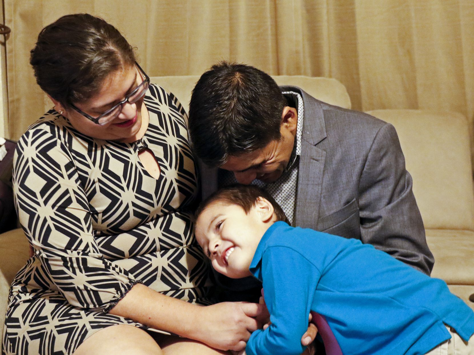 Laura Malagon, 28, Marco Antonio Malagon Sanchez, 37 and Marco Jesus Malagon Mendoza, 4, laugh in their home in Dallas on Thursday, November 21, 2019. Marco Malagon got legal status through his wife. In about a year, he will begin applying for citizenship, but the process is getting a lot more expensive.