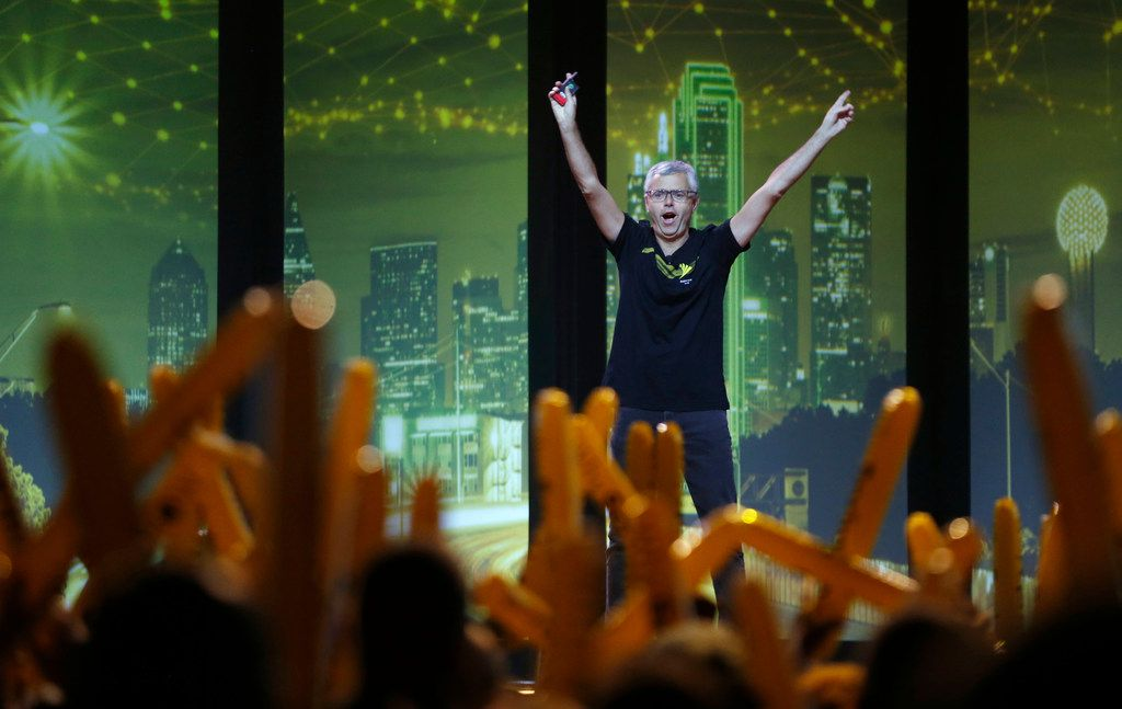 Sprint CEO Michel Combes received applause as he walks out on stage in front of employees at the Bomb Factory in Dallas on Thursday.