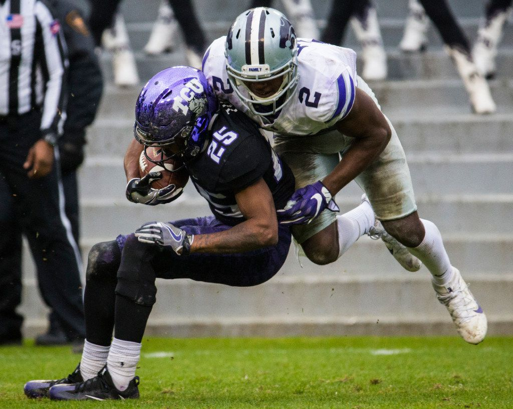 TCU Horned Frogs wide receiver KaVontae Turpin (25) is tackled by Kansas State Wildcats defensive back D.J. Reed (2) during the fourth quarter of their game on Saturday, December 3, 2016 at Amon G. Carter Stadium in Fort Worth. (Ashley Landis/The Dallas Morning News)