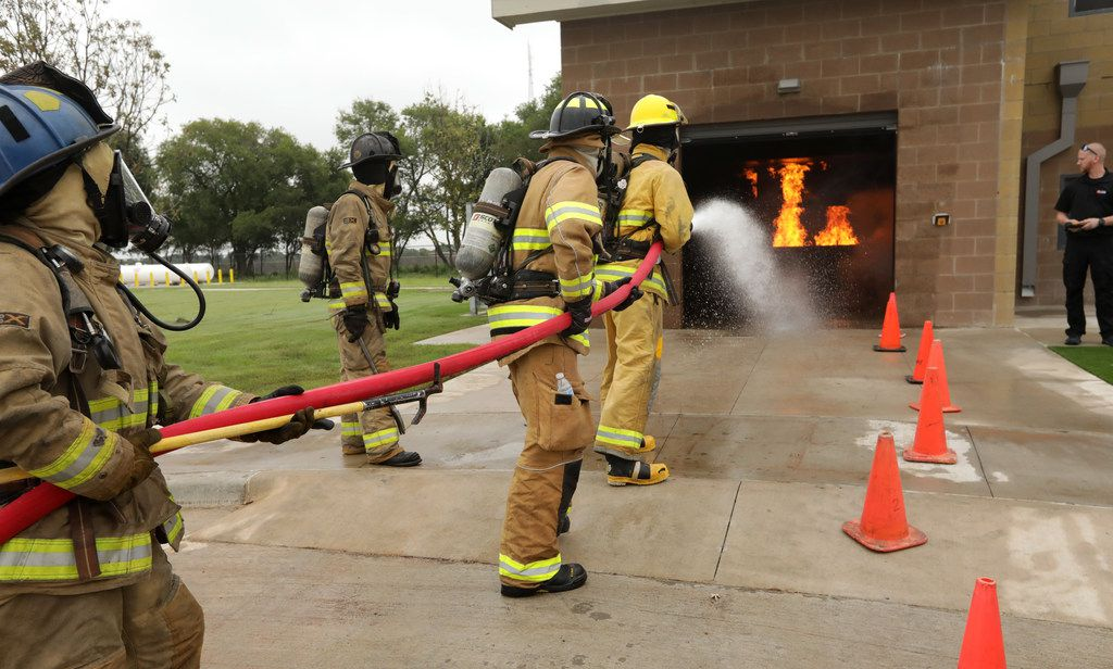Firefighters practice their techniques at the new Collin College Public Safety Training Center in McKinney.
