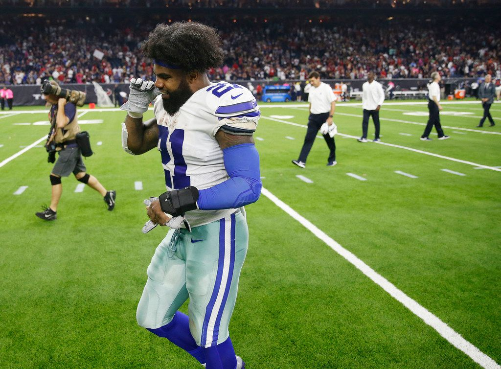 Dallas Cowboys running back Ezekiel Elliott (21) pulls his gloves off as he exits the field at NRG Stadium in Houston on Sunday, October 7, 2018. Houston Texans defeated Dallas Cowboys 19-16 in overtime. (Vernon Bryant/The Dallas Morning News)