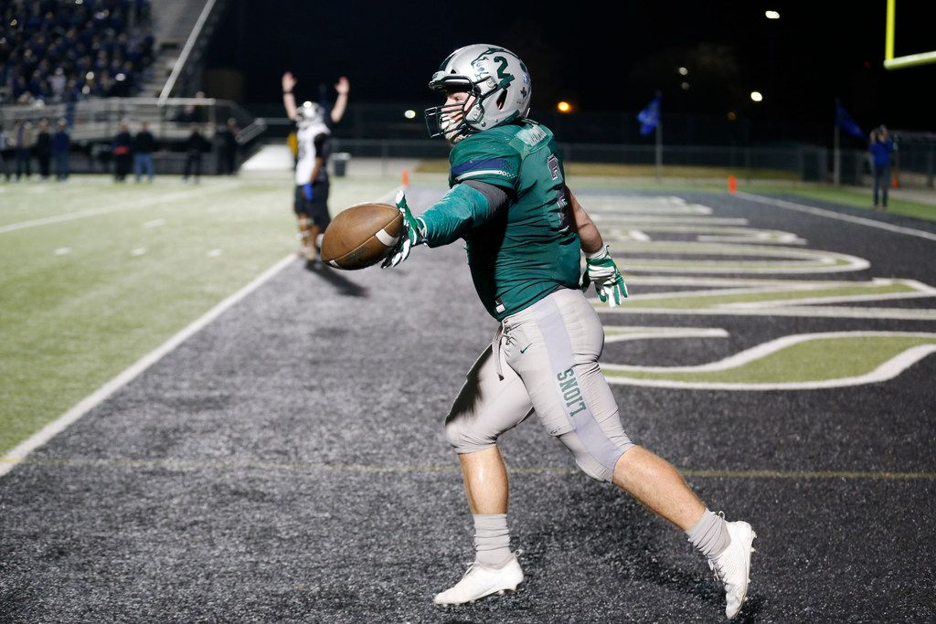 Frisco Reedy's Will Harbour  celebrates his rushing touchdown against Burleson Centennial during the first half of the Class 5A Division II Region II high school football semifinal, in Southlake, Tx, on Nov. 30, 2018. (Michael Ainsworth/Special Contributor)