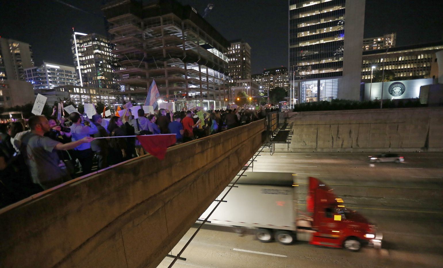 Protesters against President-elect Donald Trump march over Woodall Rodgers Freeway in downtown Dallas, Thursday, Nov. 10, 2016.