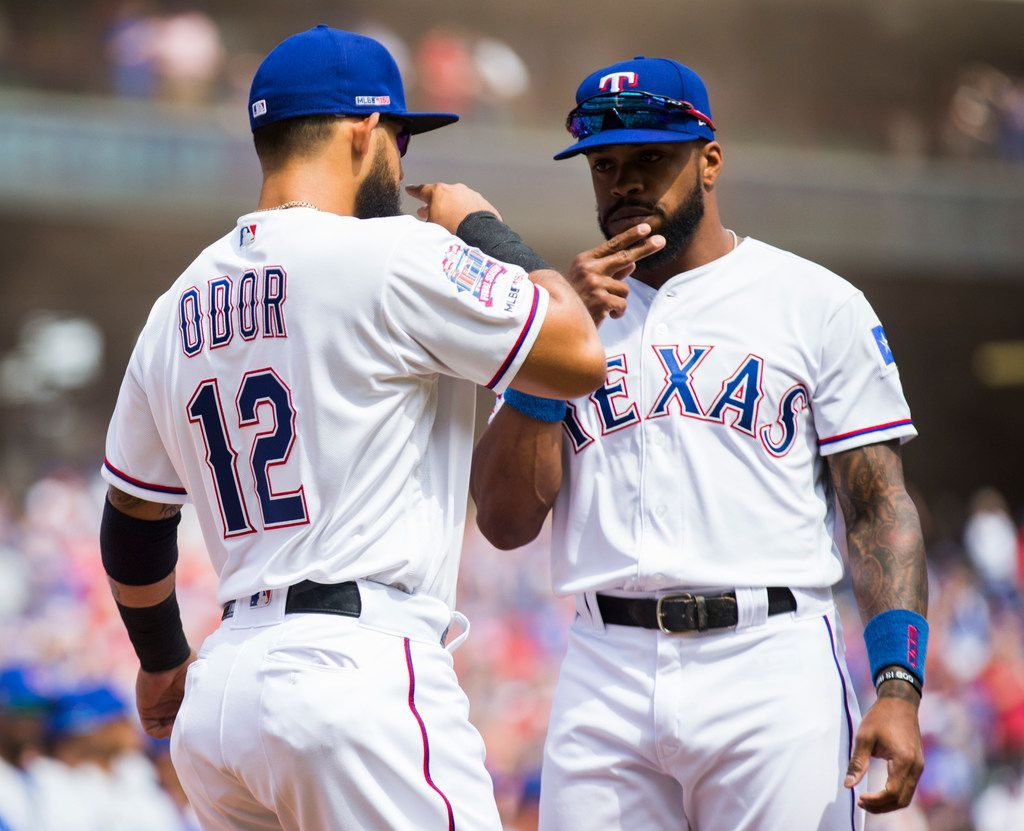 Texas Rangers second baseman Rougned Odor (12) and center fielder Delino DeShields (3) greet each other with a beard stroke before an opening day MLB game between the Texas Rangers and the Chicago Cubs on Thursday, March 28, 2019 at Globe Life Park in Arlington, Texas. (Ashley Landis/The Dallas Morning News)