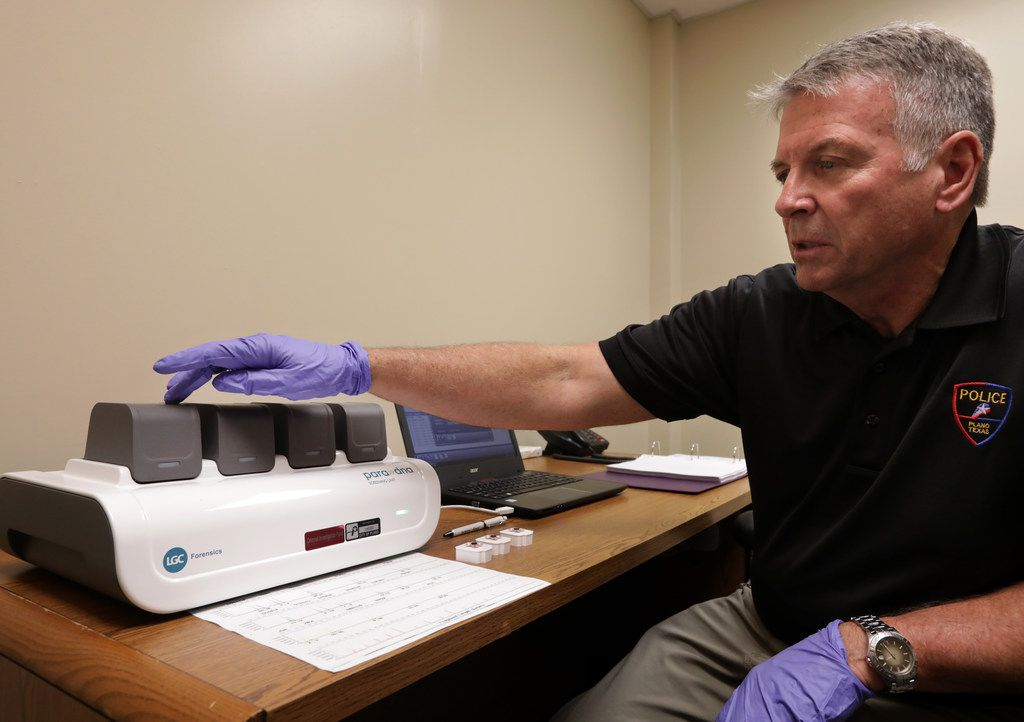 CSI and property/evidence unit manager Rick Staub runs a sample through the ParaDNA System at the Plano Police Department.