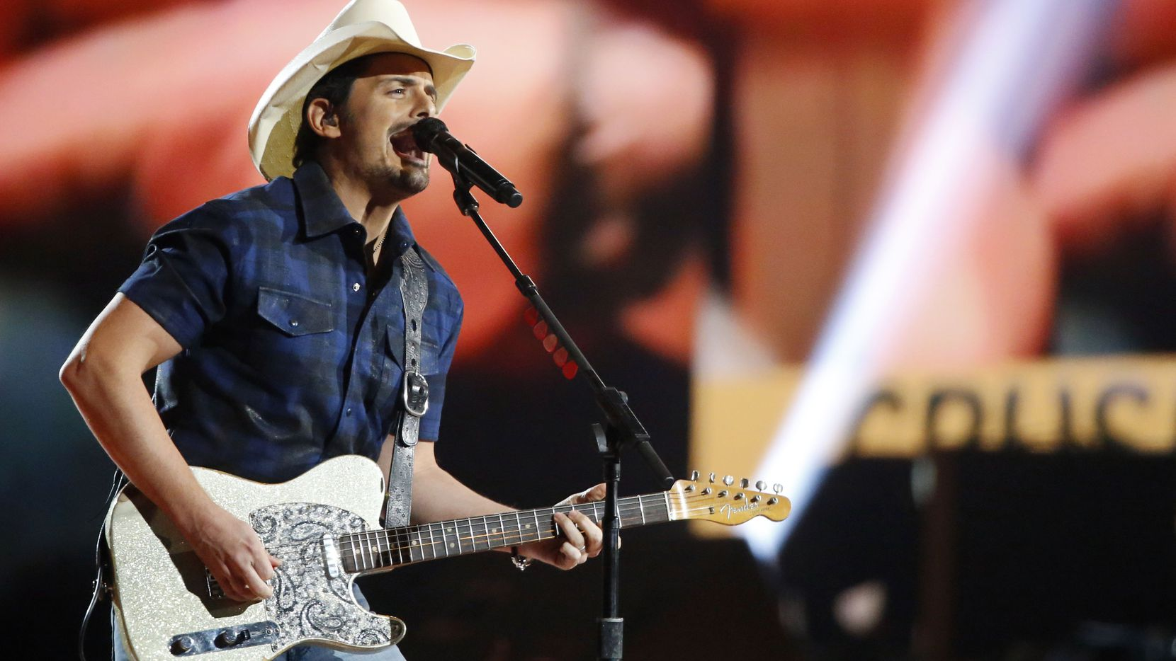 Brad Paisley performs during the 2015 Academy of Country Music Awards in Arlington on Sunday, just hours before he stopped in Rockwall for a Whataburger fix.