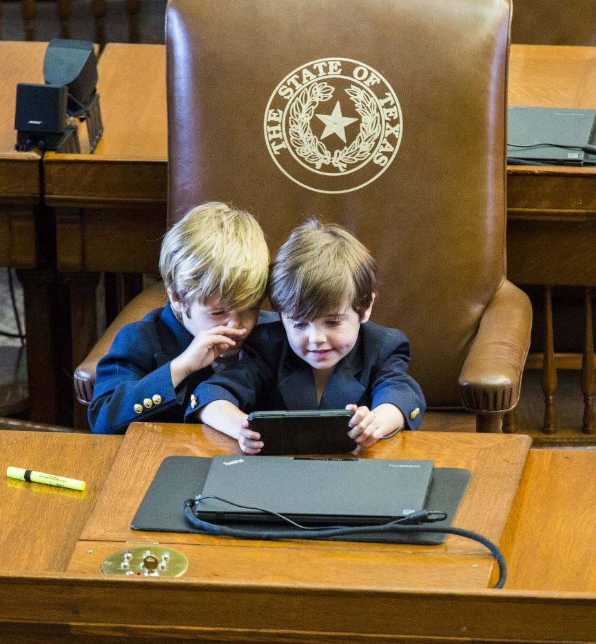 Ford Phelan, 6, and Mack Phelan, 5, play at the desk of their father, Rep. Dade Phelan, R-Port Neches, during the final day of the 84th Texas legislature regular session on Monday, June 1, 2015 at the Texas state capitol in Austin, Texas. (Ashley Landis/The Dallas Morning News) 06022015xNEWS