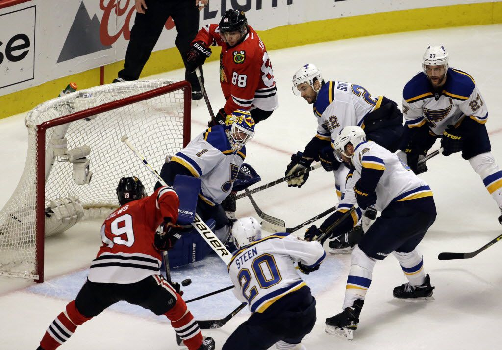 St. Louis Blues goalie Brian Elliott (1) blocks a shot against the Chicago Blackhawks during the third period in Game 6 of an NHL hockey first-round Stanley Cup playoff series Saturday, April 23, 2016, in Chicago. The Blackhawks won 6-3. (AP Photo/Nam Y. Huh)