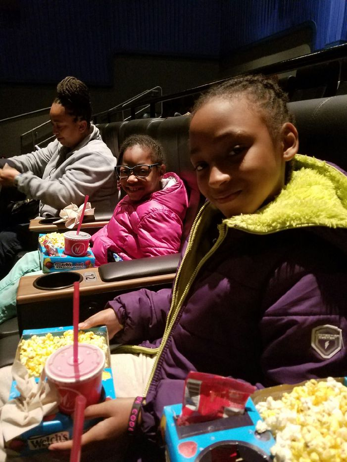 Naima Pressley (pink jacket) and a friend watched Hidden Figures in a screening hosted by Black Girls Code, a nonprofit helping young girls get involved in coding.