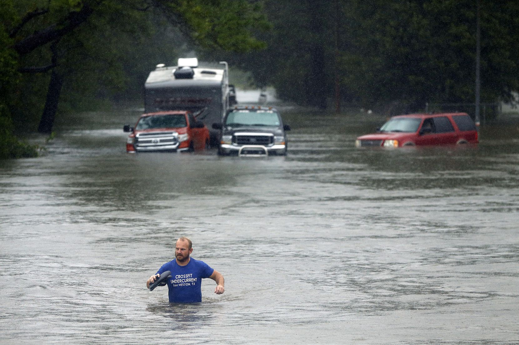 A man vacated his flooded out truck in Dickinson, Texas, Monday, August 28, 2017 after Tropical Storm Harvey dumped feet of rain on the Houston area. Residents were given a mandatory evacuation order on Monday. Some were transported to City Hall and the First Baptist Church for transport to the Brown Convention Center in Houston.