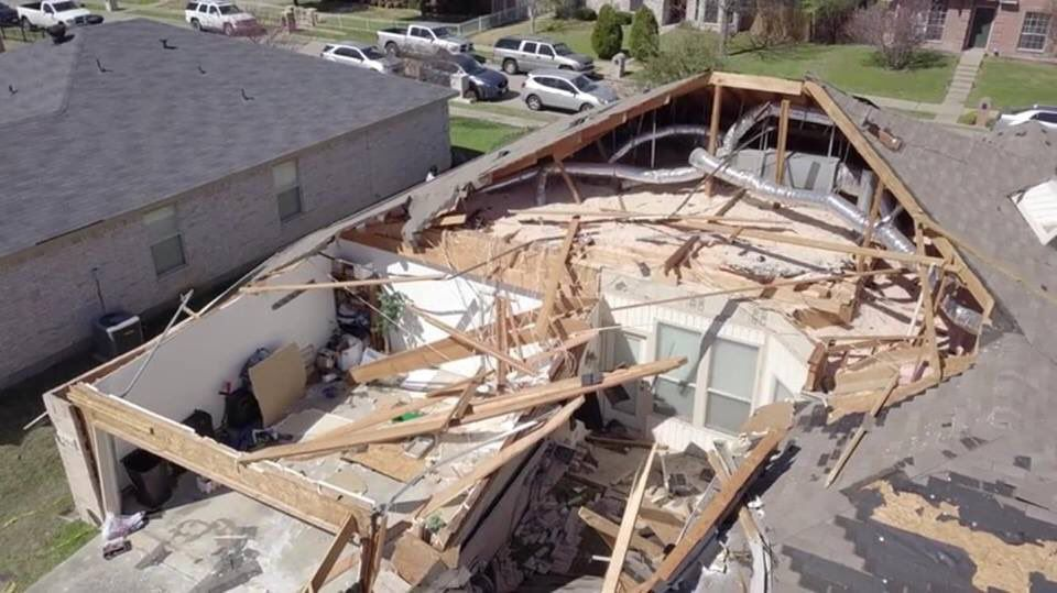 The roof of this home in Mesquite was torn off and the property destroyed after a tornado struck around 7:35 a.m.