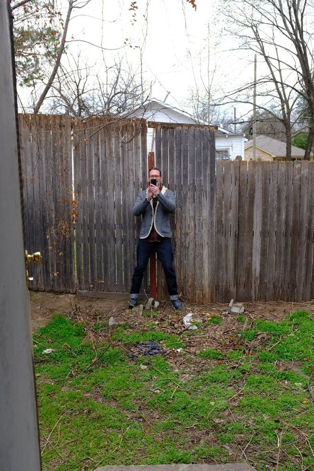 William Baker, a designer with Dallas interiors and architecture firm JonesBaker, photographs a shotgun house.
