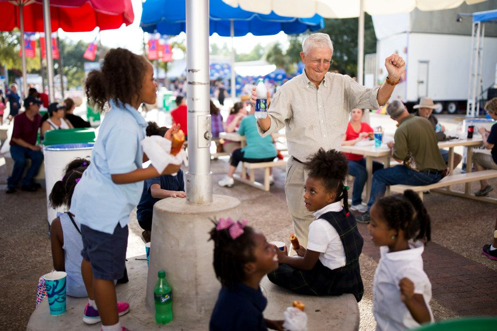 Don Williams, founder of nonprofit corporation Foundation for Community Empowerment, danced to music from a nearby stage with students from Dunbar Elementary School during the State Fair of Texas at Fair Park on Wednesday.