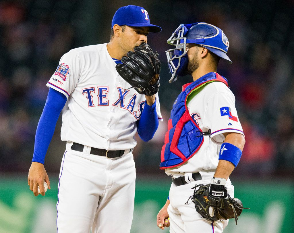 Texas Rangers relief pitcher Jeanmar Gomez (46) chats with catcher Isiah Kiner-Falefa (9) on the mound during the ninth inning of an MLB game between the Texas Rangers and the Oakland Athletics on Friday, April 12, 2019 at Globe Life Park in Arlington, Texas. (Ashley Landis/The Dallas Morning News)