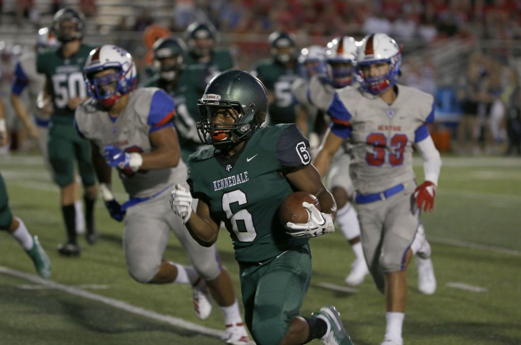 Kennedale's Cameron Hynson (6) gains yards against Midlothian Heritage during the first half of their high school football game in Kennedale, Texas on September 6, 2019. (Michael Ainsworth/Special Contributor)