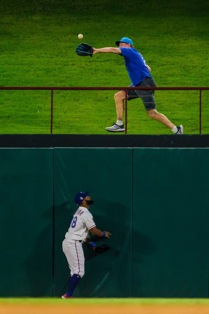 Texas Rangers center fielder Danny Santana watches as a fan makes the catch on a home run off the bat of Tampa Bay Rays first baseman Ji-Man Choi during the ninth inning at Globe Life Park on Wednesday, Sept. 11, 2019, in Arlington. (Smiley N. Pool/The Dallas Morning News)