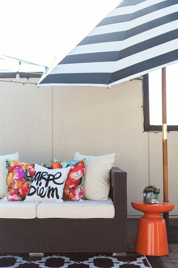 Abbe Fenimore punches up outdoor pieces with playful pillows and prints.