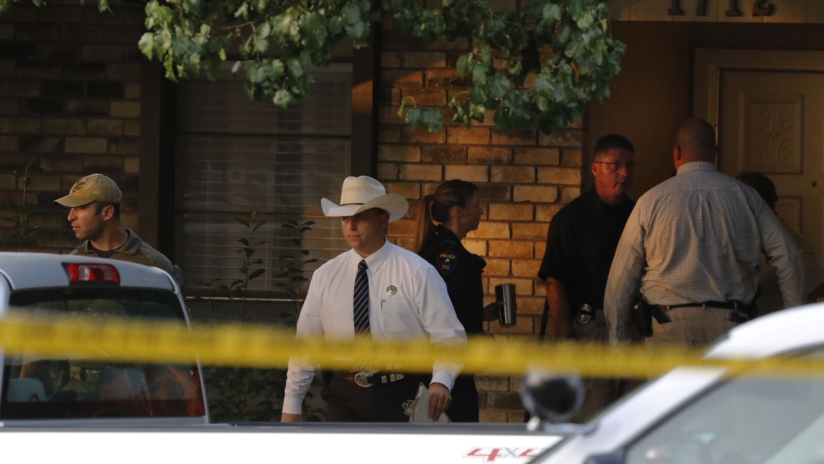 Plano police and the Texas Rangers work the scene of a shooting at a home in the 1700 block of West Spring Creek Parkway in Plano on Monday.