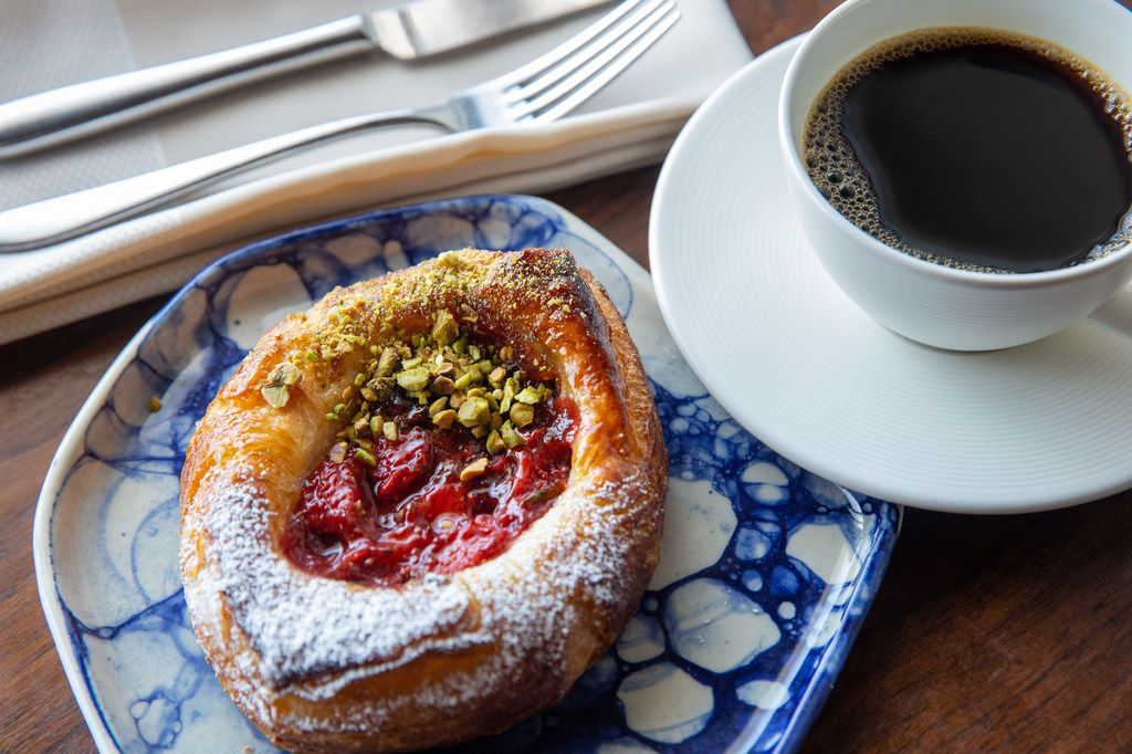 A strawberry basil Danish with pistachios --  cooked by Matt Bresnan, head chef at Food Company -- is seen in the Nonna restaurant in Highland Park in Dallas on Monday, July 1, 2019.