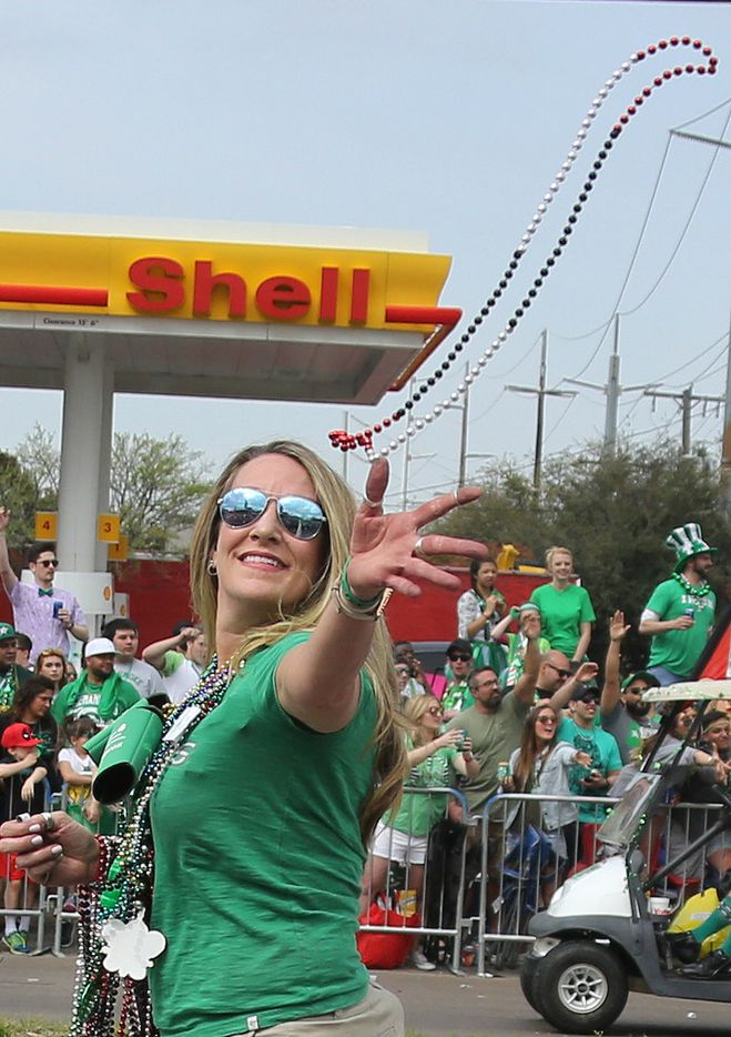 Beads are thrown to spectators along the parade route during the Dallas St. Patrick's Parade & Festival along Greenville Avenue in Dallas on Saturday.