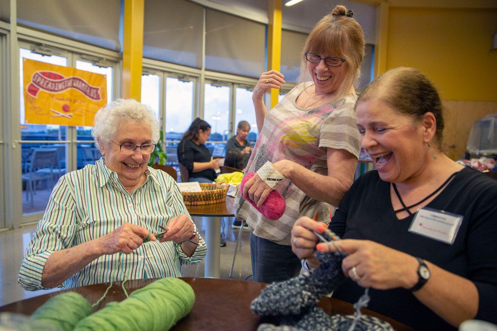 Sunny Shor (left), Nancy Bernstein (center) and Spreading the Warmth founder Christine Nicolette-Gonzalez share a laugh during the monthly Knit Night at Whole Foods in Preston Forest.