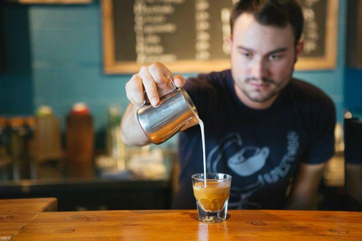 Cultivar co-founder Jonathan Meadows pours a shot of espresso.