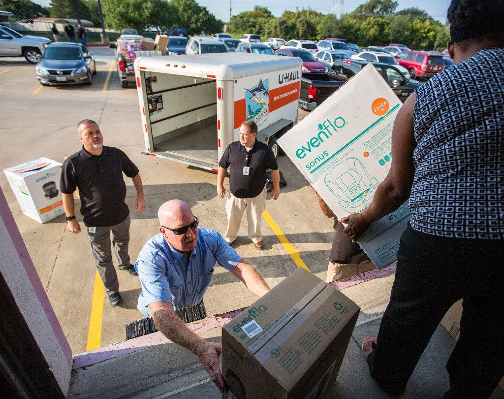 Brenda Jones, on the right, the Rainbow Room coordinator moves items to the loading dock as special investigators (from left) Tom Yarrington, Jeff Landrum and program director Greg Eakens load up a trailer as they prepare to restock the Rainbow Room in Houston with things like infant formula, cleaning supplies, hygiene items, mattresses, car seats and pack and plays at the Texas Department of Family and Protective Services office on September 11, 2017 in Austin, Texas. (Thao Nguyen/Special Contributor)