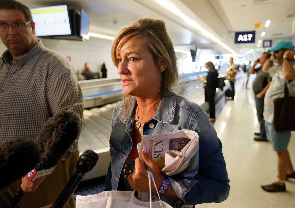 Teri Guerra, of Fort Worth, talks with the media as she arrives at Dallas/Fort Worth International Airport from Las Vegas on Monday. She was at the Route 91 Harvest Festival where Stephen Paddock opened fire killing at least 58 people and leaving more than 500 others wounded in the deadliest mass shooting in U.S. history.