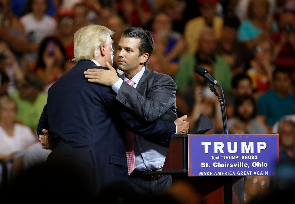 Donald Trump hugs his son Donald Trump Jr. during a presidential campaign rally at Ohio University Eastern Campus in St. Clairsville on June 28, 2016.