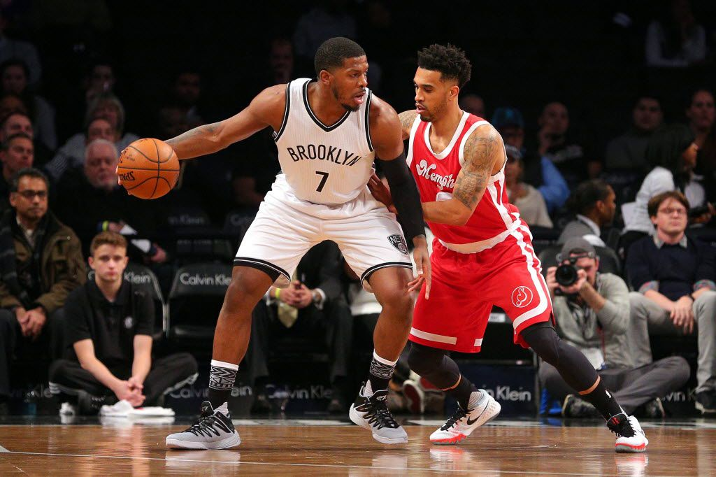 Brooklyn Nets small forward Joe Johnson (7) controls the ball against Memphis Grizzlies shooting guard Courtney Lee (5) during the first quarter at Barclays Center.