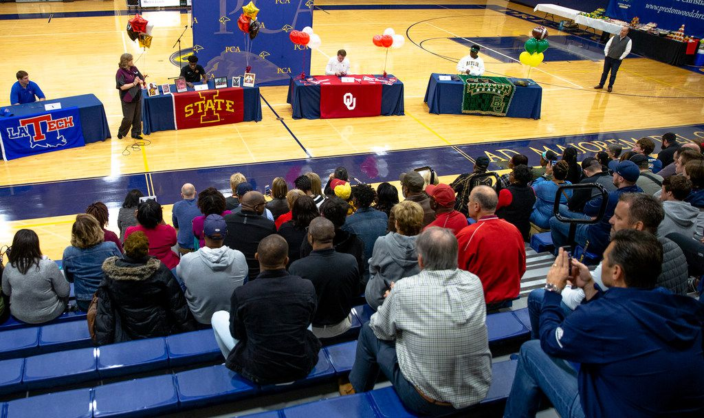 Family and friends watch as Jonah Brewster, Virdel Edwards, Austin Stogner, and Solomon Turner sign to continue playing football in college during National Signing Day event at Prestonwood Christian Academy in Plano, Texas on Wednesday, Dec. 19, 2018. (Shaban Athuman/The Dallas Morning News)