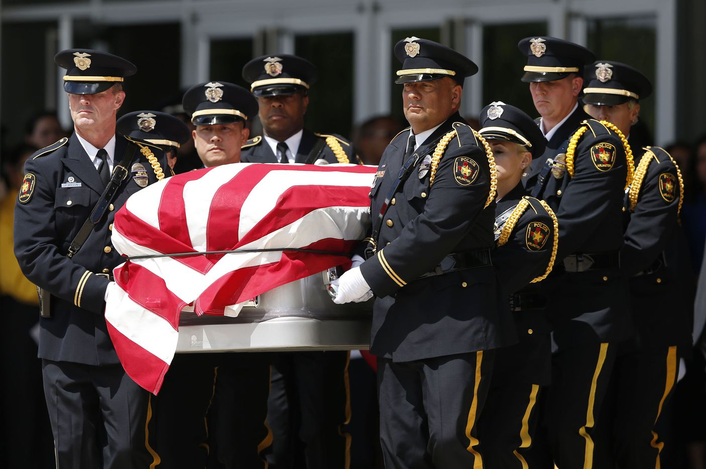 Arlington Honor Guard carry DART Officer Brent Thompson outside during a memorial service at The Potter's House in Dallas on Wednesday, July 13, 2016. Thompson was one of five officers killed last week when a gunman opened fire during a Black Lives Matter rally in downtown Dallas.