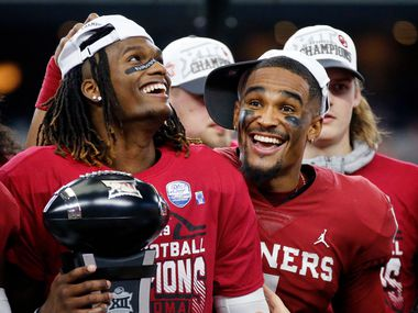 Oklahoma Sooners quarterback Jalen Hurts (right) congratulators wide receiver CeeDee Lamb on winning the most outstanding player award following their Big 12 Championship win over Baylor Bears at AT&T Stadium in Arlington, Saturday, December 7, 2019. Oklahoma won in overtime, 30-23.