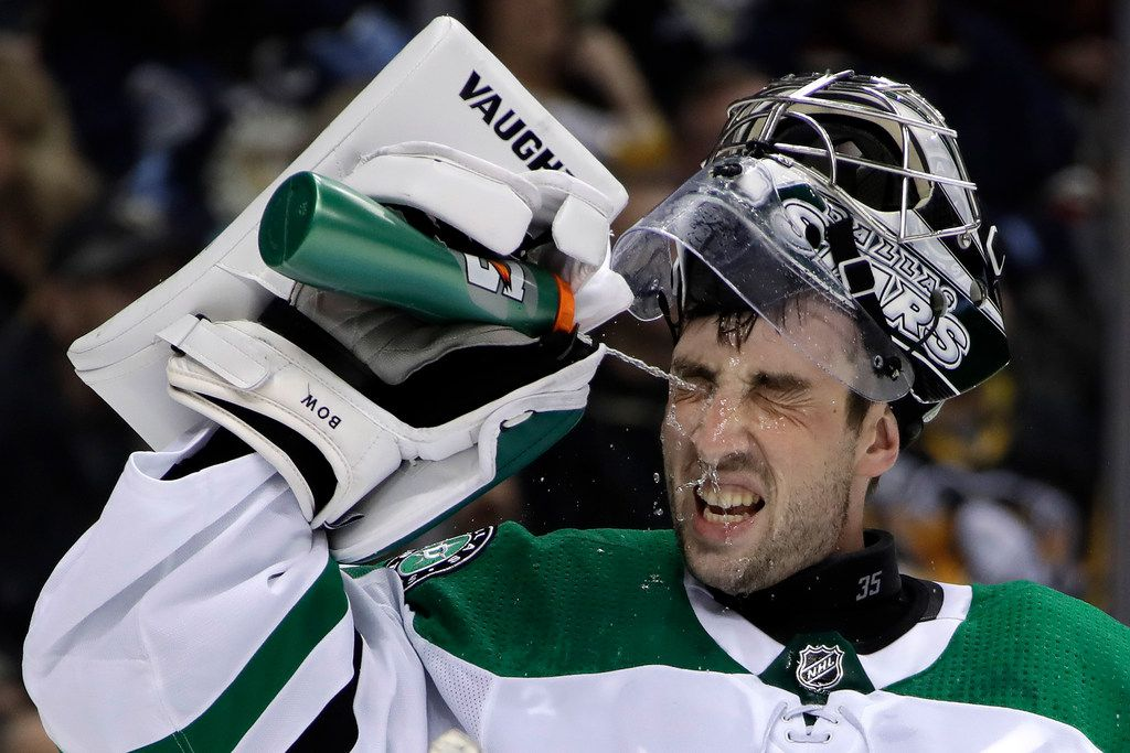 Dallas Stars goalie Landon Bow squirts water in his face during a timeout after replacing starter Anton Khudobin in the second period of an NHL hockey game against the Pittsburgh Penguins in Pittsburgh, Wednesday, Nov. 21, 2018. The Penguins won 5-1. (AP Photo/Gene J. Puskar)
